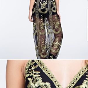 NOT FOR SALE. LOOKING FOR A JUMPSUIT SIMILAR TO TH